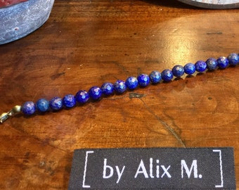 Bracelet, with clasp, in 6mm faceted Lapis-lazuli