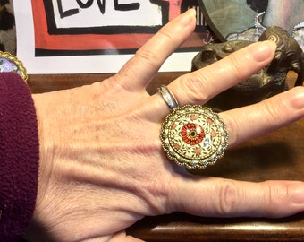 Large vintage rings with floral and butterfly motifs