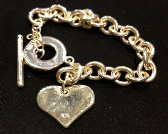 Sterling Silver heart charm bracelet with toggle clasp 8 inches.