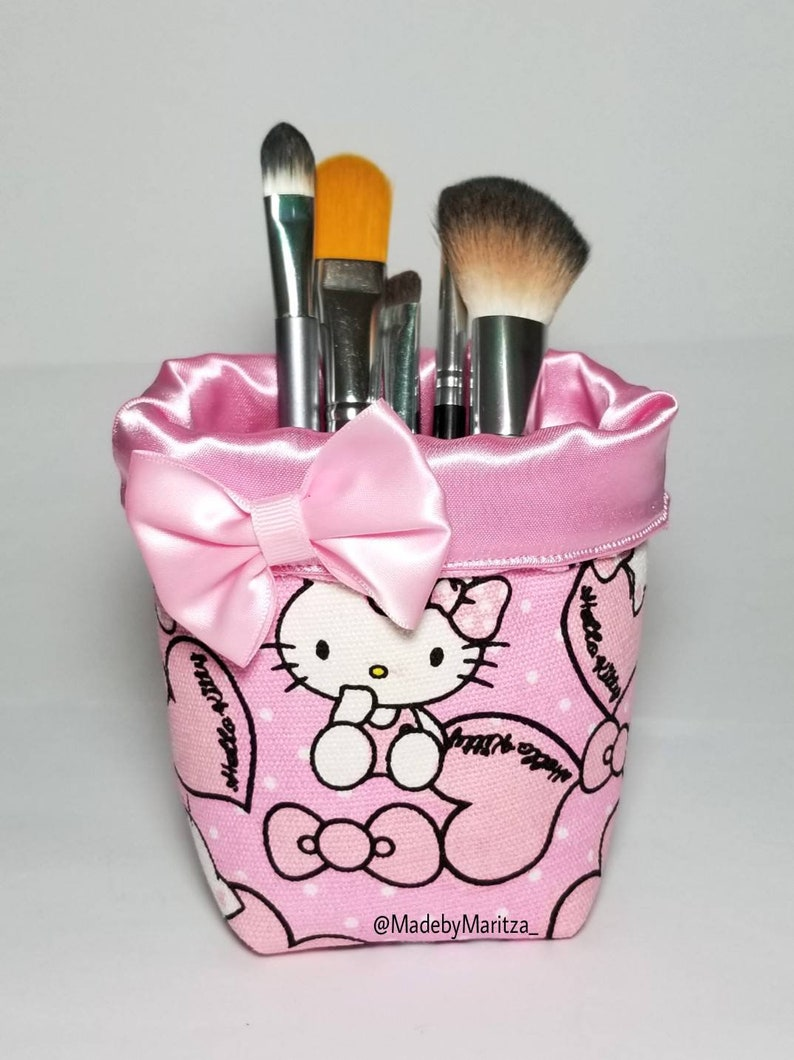 155392be2da Foldable Hello kitty makeup brush holder fabric cup. Travel.