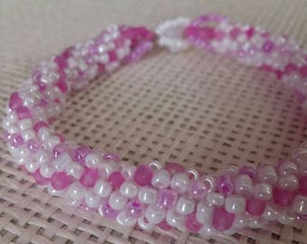 White and pink bead woven bracelet