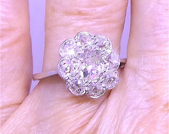 Stunning Diamond daisy cluster engagement ring in Platinum