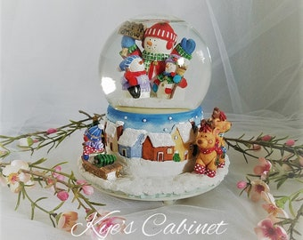christmas musical snow globe by san francisco music box company snowman family rotating water globe music box holiday decor - Christmas Musical Snow Globes