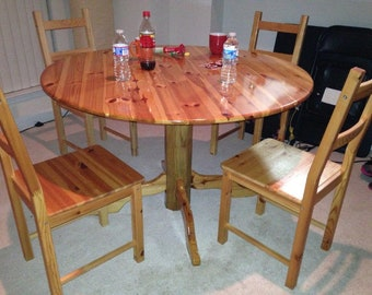 Knotty Pine Pedistal Table With Four Chairs