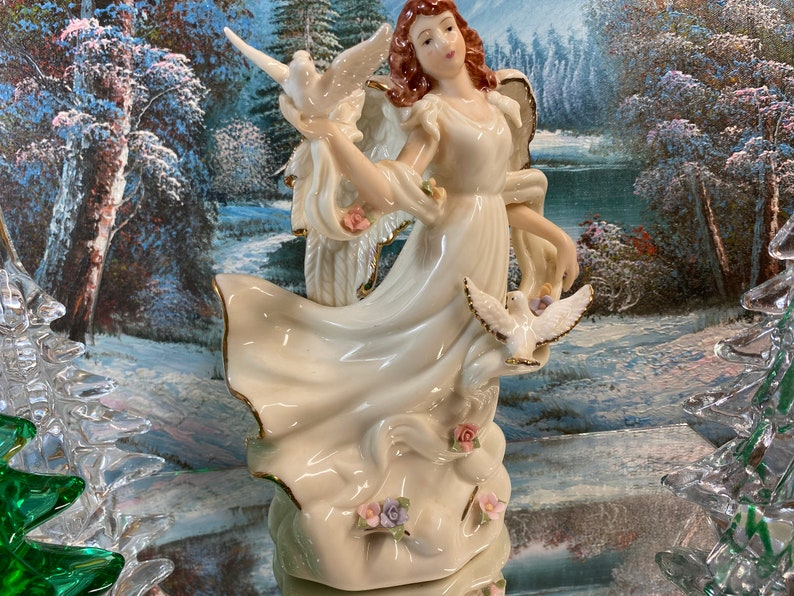 Porcelain Angel with Applied Flowers Doves and a Long Flowing Scarf 1998
