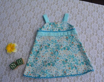 Baby girl sundress with ric rac trim.  Newborn size. Cotton Baby Dress with open skirt at back.
