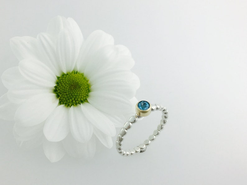 Stacker ring in Gold & Silver with Blue topaz image 0
