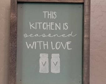 This kitchen is seasoned with love, chalk sign