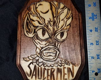 Invasion of the Saucermen wood plaque