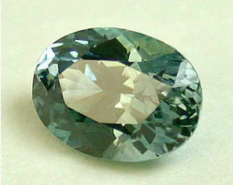 VINTAGE Montana Rock Creek SAPPHIRE Blue-Green Faceted GEMSTONE oval 6x4.5mm 0.74 cts src29