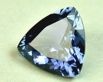 VINTAGE YOGO blue SAPPHIRE Faceted Montana Gemstone trillion 0.33cts syo3