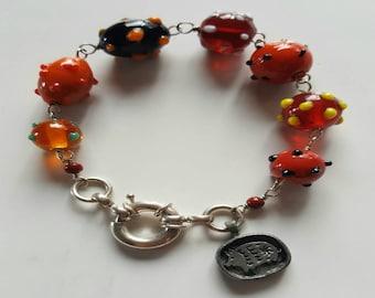 Orange Lamp Work Beaded Bracelet with Sterling Silver