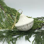 White thrown ornament with gold line details at bottom