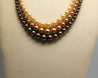 Citation Faux Pearl and Gold Bead Necklace on Gold Tone Mesh Background Ombre Effect.
