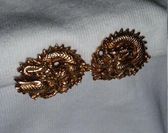 Glod tone dragon motif clip on earrings