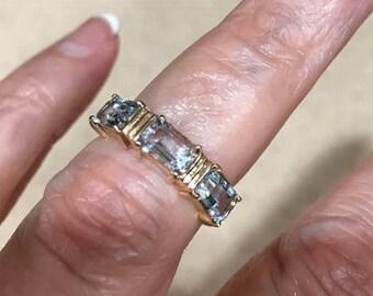 Emerald cut, aquamarine stones, gold ring