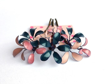 Three hair clips with delicate blossoms