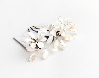 Three hair clips with delicate flowers