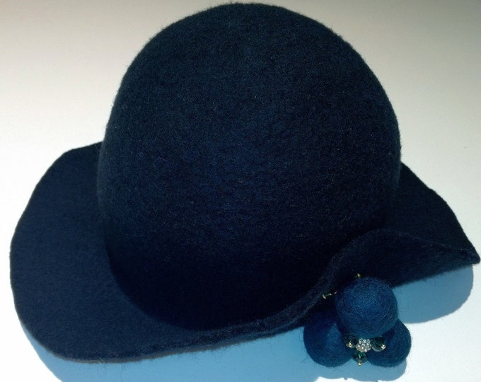 Decorated felt wool hat with a wool brooch and Swarovski glass beads