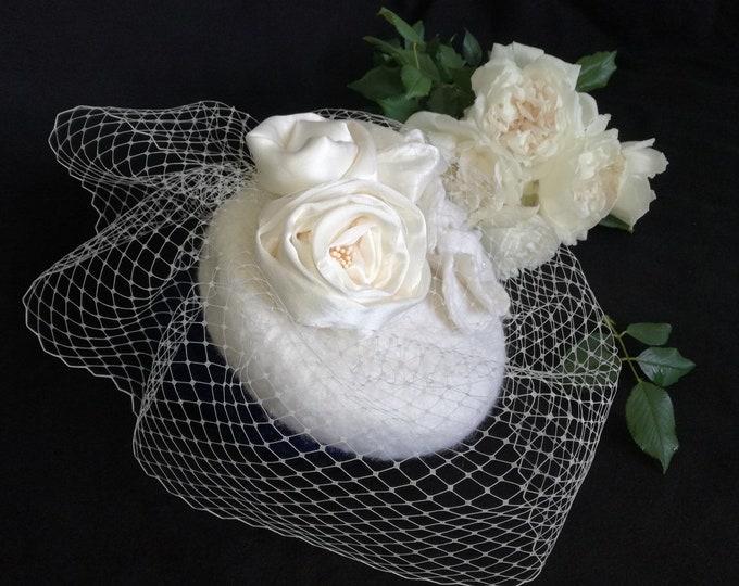 Small wedding hat in felted merino wool.