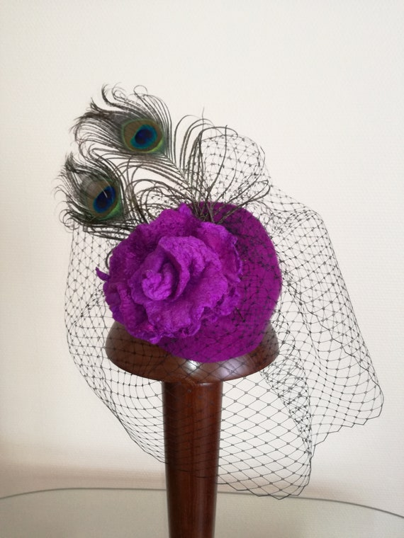 Hat in wool Merino with a pink wool, peacock feathers and veil