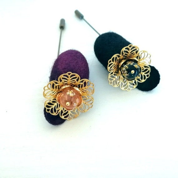 Silkworm cocoon brooches with glass beads.