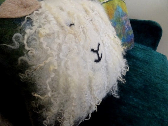 Decorative cushion in felted wool. Little lamb.