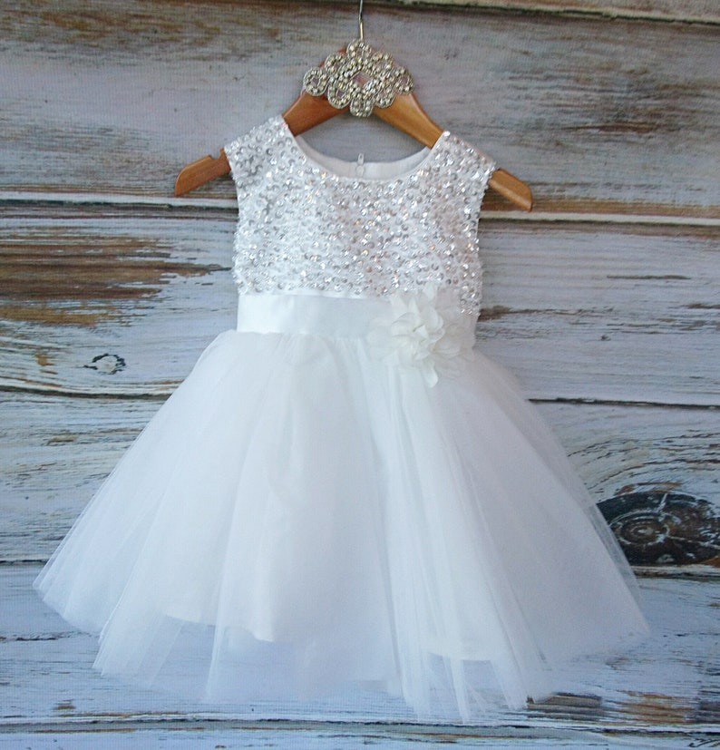 Baby Girls Soft white Ivory Elegant Flowergirl Dress Baptism Dress Sequin bodice with a chiffon flower sash.