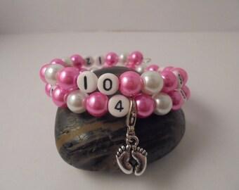 Nursing breast or bottle pink and white bracelet