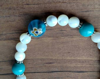 Handmade beaded bracelets with glass flower beads and shell beads