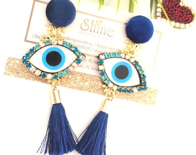 Evil eye earrings. Blue tassel earrings. Handmade earrings. Statement jewelry.
