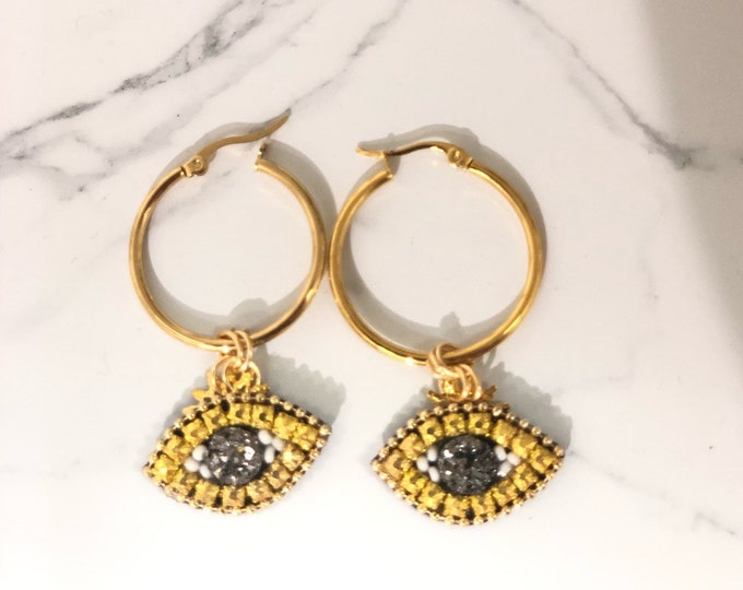 Ring with golden evil eye, evil eye earrings,  handmade earrings, statement earrings.