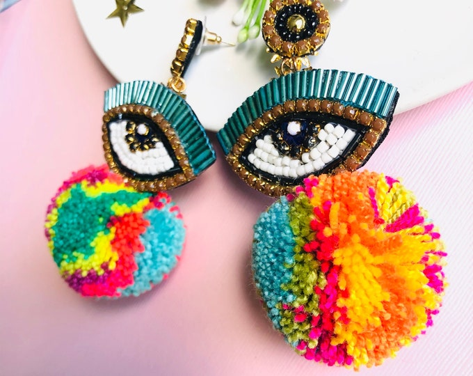 Handmade Evil eye earring, evil eye charm earrings, colorful pom pom earrings, statement earrings, edgy evil eye earrings