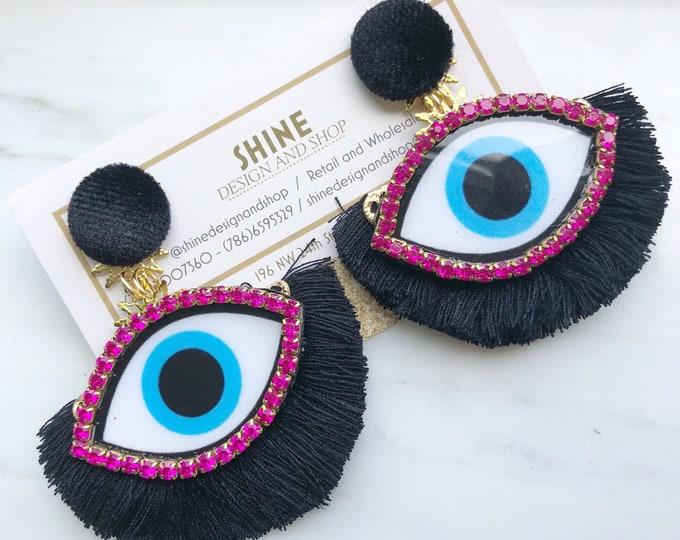 Handmade evil eye with hot pink rhinestones and black fan tassel