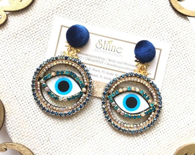 Handmade woven evil eye earrings