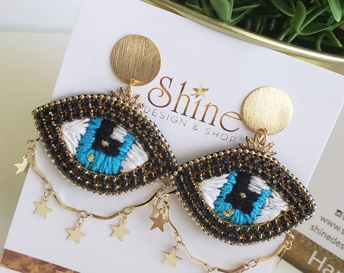Hand embroidered evil eye earrings . And start chain