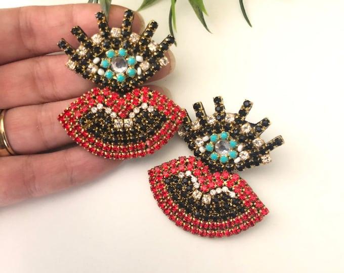 Evil eye earrings, mouth earrings, handmade earrings, statement earrings, rhinestone earrings.