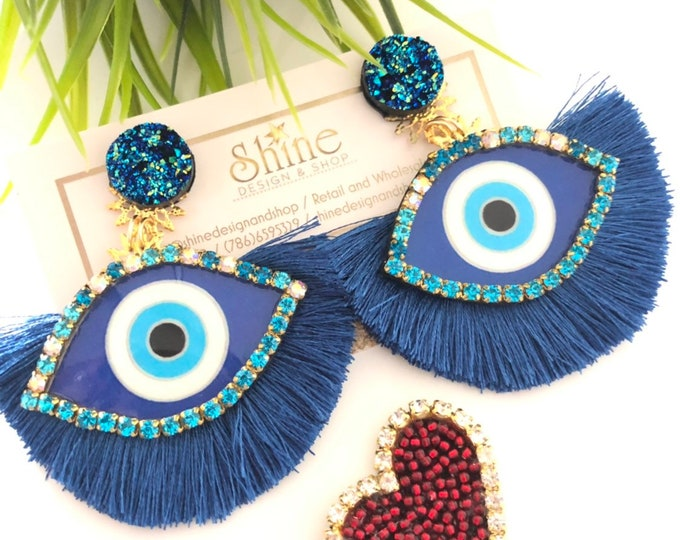 Evil eye earrings. blue tassel earrings. Handmade. Statement jewelry