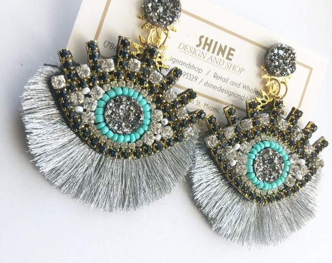 Handcrafted evil eye Earrings with tassels