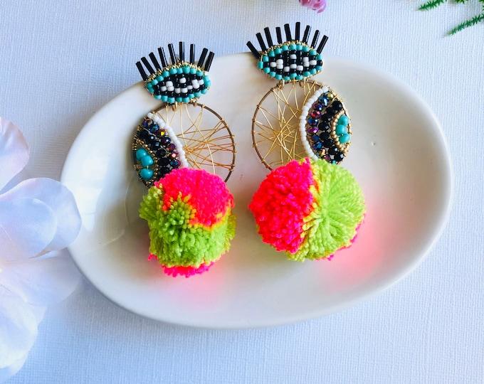 Evil eye earring, handmade wire earrings, big pom pom earrings, statement earrings, wanderlust earrings
