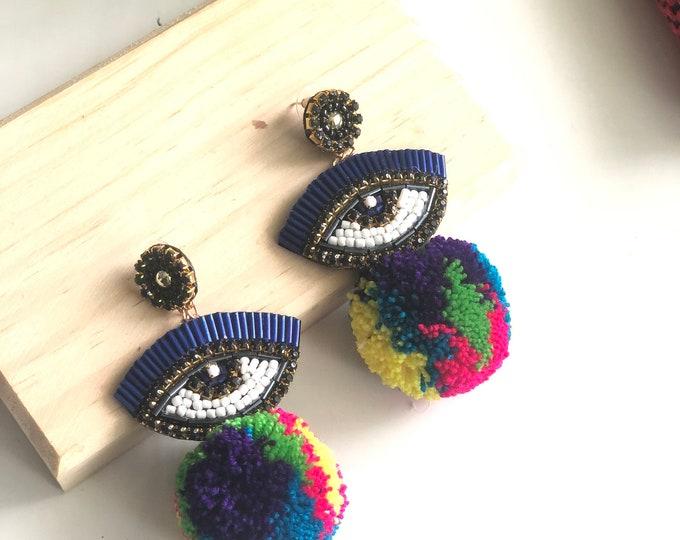 Handmade pom pom Evil eye earrings. Colorful earrings. Statement.