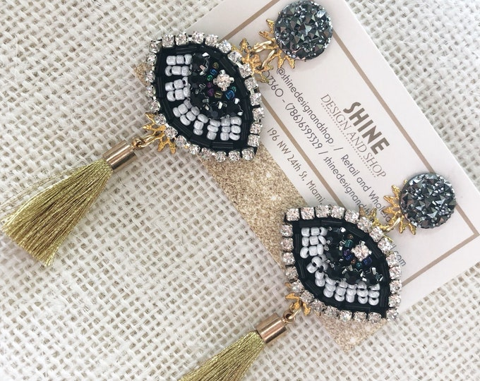 evil eyes. Statement earrings