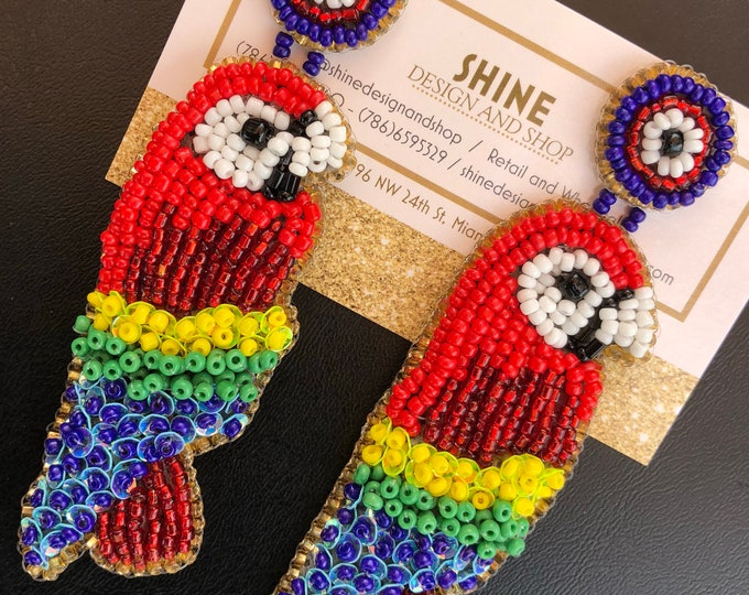 Handmade beaded parrots.