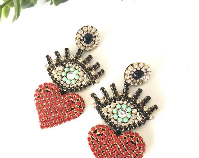 handmade eye and heart earring