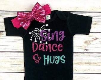 {Sing Dance & Hugs}