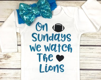 {On Sundays We Watch The Lions}