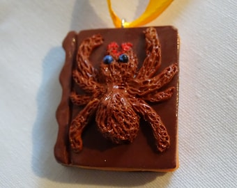 book pendant on spiders for halloween
