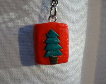 christmas book keychain with a fir tree
