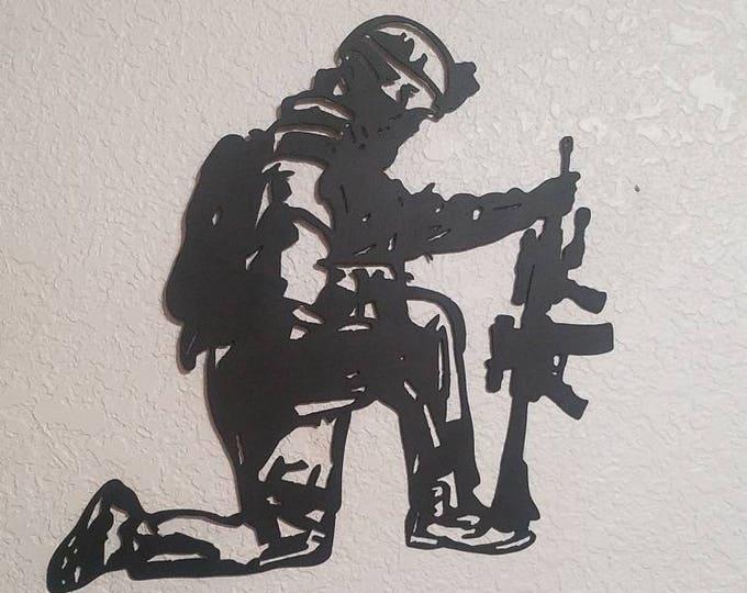 The Veteran's Prayer.    Veteran  kneeling in prayer. Metal Art  Veterans prayer.