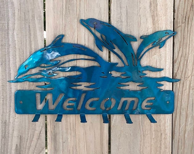 Dolphin welcome key hanger art.